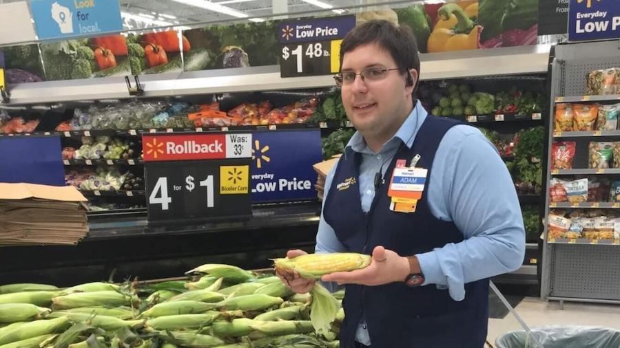 Adam from Walmart posing by his award
